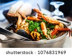 closeup mix seafood soup pot | Shutterstock . vector #1076831969