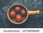 indian sweet gulab jamun ... | Shutterstock . vector #1076858684