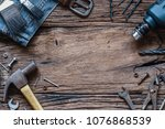 Small photo of Top view close up of variety handy tools and jeans on wood background with copy space for your text for Worker's day, Labor's day, labour's day background.
