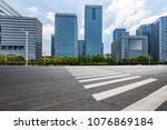 empty road with modern business ... | Shutterstock . vector #1076869184