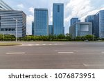 empty road with modern business ... | Shutterstock . vector #1076873951