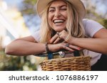 attractive woman leaning on her ... | Shutterstock . vector #1076886197