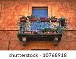 Italian balcony with vases and flowers - stock photo