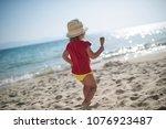 cool little girl with icecream... | Shutterstock . vector #1076923487