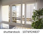 tilt and turn white pvc window... | Shutterstock . vector #1076924837