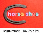 a horseshoe with the word horse ... | Shutterstock . vector #1076925491