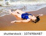 girl in a blue bathing suit... | Shutterstock . vector #1076986487