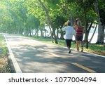 Elderly Couple Women Walking...