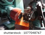 sharpening of cutters on the... | Shutterstock . vector #1077048767