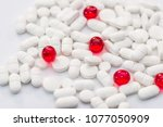 many white and red pills on... | Shutterstock . vector #1077050909