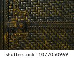 metal door with a carved round... | Shutterstock . vector #1077050969
