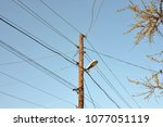 the post is electric with wires ... | Shutterstock . vector #1077051119