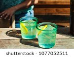 refreshing drinks with ice and... | Shutterstock . vector #1077052511