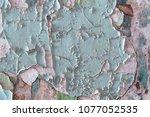 peeling paint on a cement wall. ... | Shutterstock . vector #1077052535