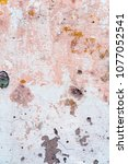 remains of pinkish paint on the ... | Shutterstock . vector #1077052541