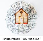 investment. model house on top... | Shutterstock . vector #1077055265