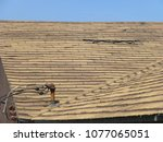 old damaged brown asphalt... | Shutterstock . vector #1077065051