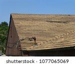 old damaged brown asphalt... | Shutterstock . vector #1077065069