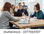 dedicated young business people ... | Shutterstock . vector #1077065507
