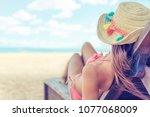 young woman whit sun hat... | Shutterstock . vector #1077068009