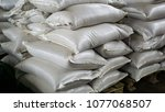 filled white plastic bags are...   Shutterstock . vector #1077068507