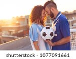 couple in love wearing football ... | Shutterstock . vector #1077091661