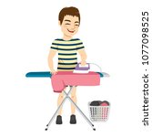 happy young man ironing pink... | Shutterstock .eps vector #1077098525