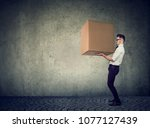 side view of casual man lifting ... | Shutterstock . vector #1077127439