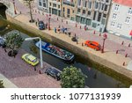 Small photo of Den Haag, Netherlands - April 8, 2018: Madurodam miniature museum park is a famous attraction. Mini human figures, cars, buildings, trains, bridges, ships and a garden of giant tulips await tourists.