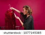 shocked woman looking at price... | Shutterstock . vector #1077145385