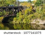 Railroad bridge over the Wisconsin River in the wisconsin dells, with reflection of the bridge in the water.