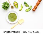 make spinach pancakes. white... | Shutterstock . vector #1077175631