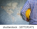 engineer or worker holding in... | Shutterstock . vector #1077191471