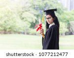 happy graduate young asian... | Shutterstock . vector #1077212477