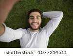 close up shot of a young man... | Shutterstock . vector #1077214511