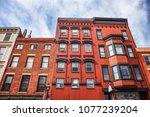 building facade along main... | Shutterstock . vector #1077239204