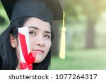 happy graduate young asian... | Shutterstock . vector #1077264317