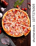 fresh pizza with tomatoes ... | Shutterstock . vector #1077276305
