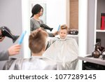 professional female hairdresser ... | Shutterstock . vector #1077289145