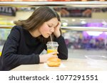 teenage girl in cafe eating... | Shutterstock . vector #1077291551