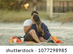 unknown couple kisses... | Shutterstock . vector #1077298985