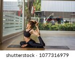 woman wearing a black gym is... | Shutterstock . vector #1077316979