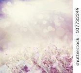 Stock photo background with flowers in a beautiful meadow and cloudscape with bokeh lights 107732249