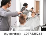 professional female hairdresser ... | Shutterstock . vector #1077325265