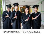 group of multiethnic students... | Shutterstock . vector #1077325661