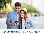 couple of tourists consulting a ... | Shutterstock . vector #1077337874