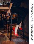 beautiful girl in drinks aperol ...   Shutterstock . vector #1077350579