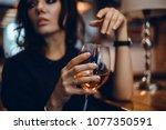 beautiful girl in drinks aperol ... | Shutterstock . vector #1077350591