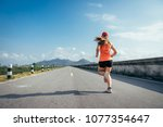 an asian woman athletic is... | Shutterstock . vector #1077354647