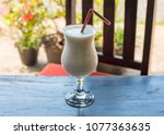 white cocktail on wooden table. ... | Shutterstock . vector #1077363635